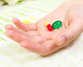 Closeup of woman hand holding two pills Stock Image