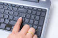 Closeup woman hand touch enter key finger point Stock Photography