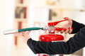 Closeup woman hands with red nailpolish showing how to operate fire extinguisher Royalty Free Stock Photo