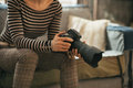 Closeup on woman with modern dslr photo camera Royalty Free Stock Photo
