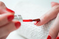 Closeup of a woman painting her nails Royalty Free Stock Photo
