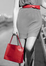 Closeup of woman with red shopping bag and belt walking Royalty Free Stock Photos