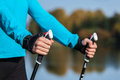 Closeup of woman s hand with nordic walking poles exercise adventure hiking concept holding Stock Photos