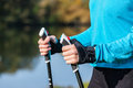 Closeup of woman s hand with nordic walking poles exercise adventure hiking concept holding Stock Photography