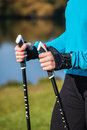 Closeup of woman s hand with nordic walking poles exercise adventure hiking concept holding Royalty Free Stock Photo