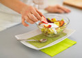 Closeup on woman serving fresh fruit salad Royalty Free Stock Photo