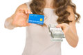 Closeup on woman showing credit card and money pac Royalty Free Stock Photography