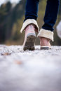 Closeup of a woman walking along a rural path Royalty Free Stock Photo