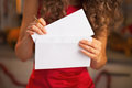 Closeup on womanputting christmas letter into envelope woman in red dress putting Stock Images