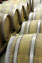 Closeup of wooden barrels for maturing and storing wine underground cellar close up ageing industrial production barrique Stock Photography