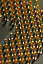 Closeup of yellow computer processor pins or computer technology background Stock Photos