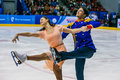 Closeup young athletes figure skaters on ice sports arena Royalty Free Stock Photo