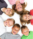 Closeup of young boys and girls lying in a circle Royalty Free Stock Photos