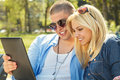 Closeup of young couple using a digital tablet Stock Image