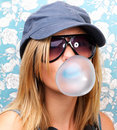 Closeup of a young girl blowing bubble gum Stock Photography