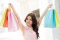 Closeup young girl holding shopping bags up Royalty Free Stock Photo