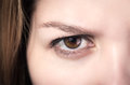 Closeup of young girl's brown eye Royalty Free Stock Photo