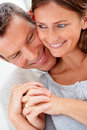 Closeup of a young happy couple holding hands Royalty Free Stock Image