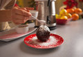 Closeup on young housewife decorating apple in chocolate glaze kitchen Royalty Free Stock Image