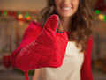 Closeup on young housewife in kitchen gloves showing thumbs up Royalty Free Stock Photo