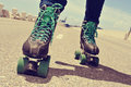 Closeup of a young man roller skating, with a cross-processed ef Royalty Free Stock Photo