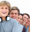 Closeup of young smiling friends standing in a row Stock Photos