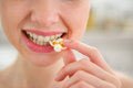 Closeup on young woman eating popcorn Royalty Free Stock Photo