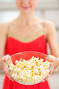 Closeup on young woman giving popcorn Royalty Free Stock Photo