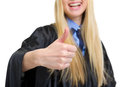 Closeup on young woman in graduation gown showing thumbs up Royalty Free Stock Photos