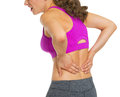 Closeup on young woman having back pain isolated white Stock Photos