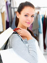 Closeup of a young woman holding bags at a shop Royalty Free Stock Photo
