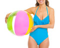 Closeup on young woman in swimsuit with beach ball Royalty Free Stock Photo