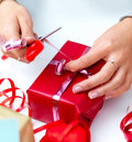 Closeup of a young woman wrapping gift Royalty Free Stock Photography