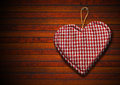 Cloth heart on brown wood background handmade clothe hanging wooden Stock Image