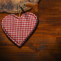 Cloth heart on brown wood background handmade clothe hanging wooden with trunk section Stock Photos