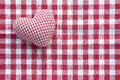 Cloth heart from checked pattern fabric on a red and white check Royalty Free Stock Photo