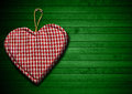 Cloth heart on green wood background handmade clothe hanging wooden Stock Photography
