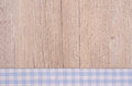 Cloth with light blue checks on wooden background old Royalty Free Stock Photography