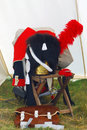 Clothes and assesoires of a military man napoleonic wars times put on chair fur bag is put on the ground red plumage Stock Photos