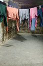 Clothes on clothesline in old unhygenig basement Royalty Free Stock Image