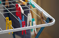 Clothes dryer colorful pins for drying after laundry airer Stock Images