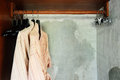 Clothes hanger and bathrobe in wardrobe Stock Images