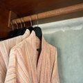 Clothes hanger and bathrobe in wardrobe Royalty Free Stock Photography