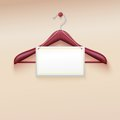 Clothes hanger with tag on cream background vector illustration realistic this is file of eps format Royalty Free Stock Image