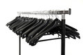 Clothes hangers empty black on a metal stand Royalty Free Stock Photos