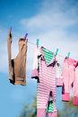 Clothes hanging on clothesline different outside Stock Photos