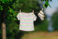 Clothes hanging on line in garden Royalty Free Stock Photo