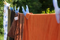 Clothes hanging on a rope to dry outside Royalty Free Stock Photography