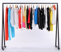 Clothes hanging on a shelf Stock Photography