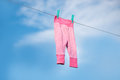 Clothes laundry on line hanging outside Stock Photo